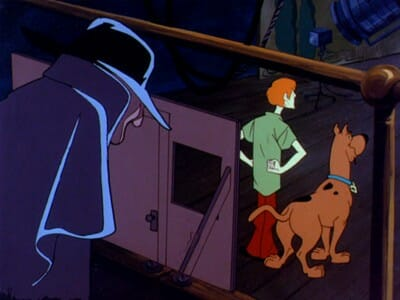 Masked man watches Scooby and Shaggy