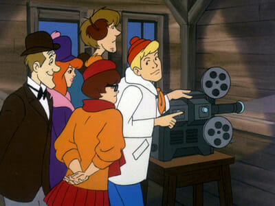 Fred and gang with projector