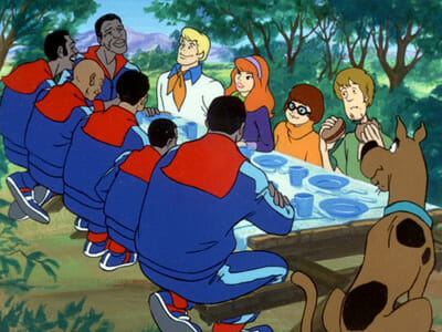 Scooby gang eating in park with Globetrotters
