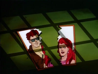Torn photo of Cyclops and Jean