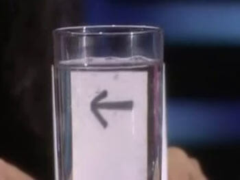 arrow behind glass of water