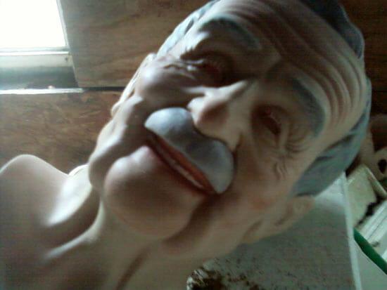 laughing elderly man doll