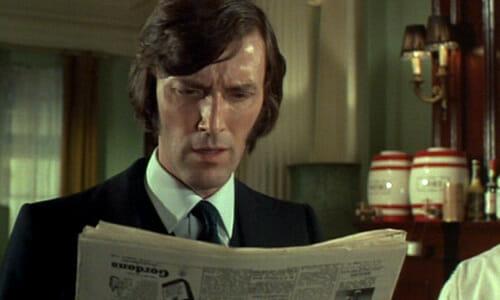 Colin reading newspaper