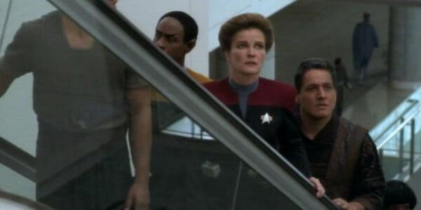 Tuvok, Janeway, and Chakotay on escalator