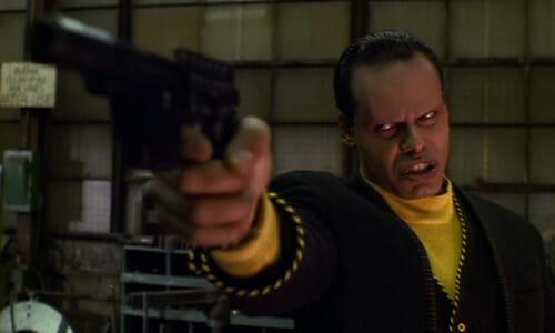 Winger pointing gun