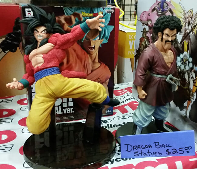 Super Saiyan 4 Goku and Mr. Satan statues