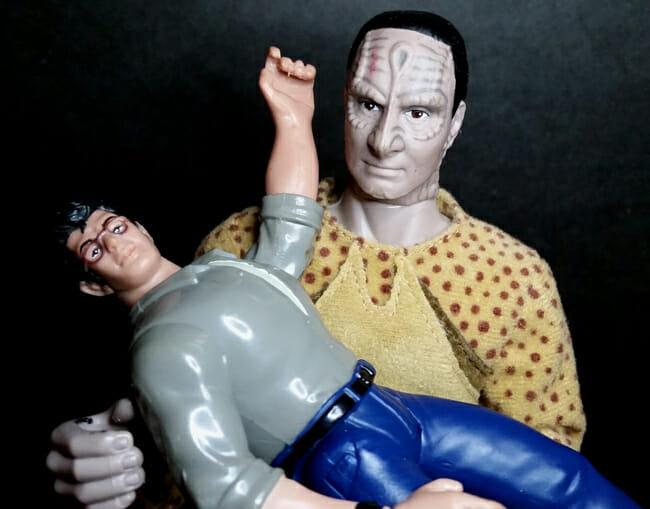 Garak holding David Levinson in his arms