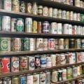 Bookshelf full of empty beer cans