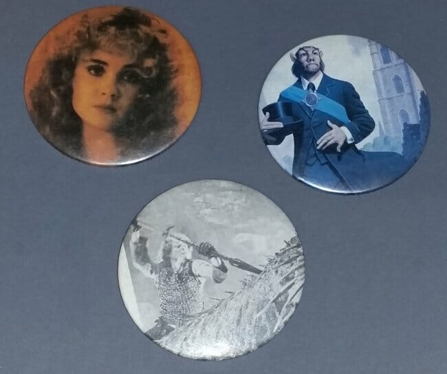 Pinback button of woman, centaur, and man with spear hunting large creature