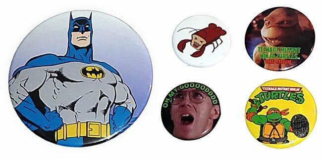 Pinback buttons of Batman, Bread Lobster, Troll 2 guy, and Ninja Turtles