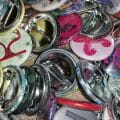 Pile of pinback buttons with letters on them