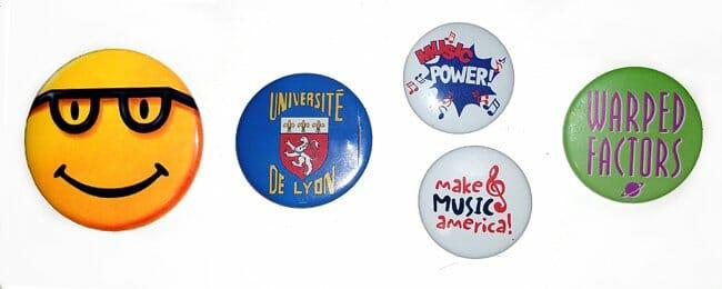 Pinback buttons of Microsoft Bob, Université de Lyon, two music buttons, Warped Factors